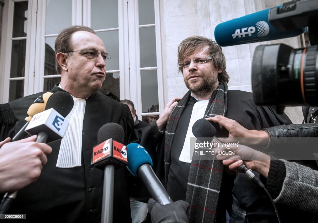 Denis Tailly-Eschenlohr (R) and Herve Krych (L), the lawyers of French General Christian Piquemal accused of taking part in a banned anti-migrants demonstration, announce to the press the report of the trial for health reasons on February 8, 2016 at the courthouse of Boulogne-sur-Mer, northern France. French General Christian Piquemal is accused with four other of taking part in a banned anti-migrants rally called by Pegida (Patriotic Europeans Against the Islamisation of the Occident) movement. His trial is reported to May 12, 2016. / AFP / PHILIPPE HUGUEN
