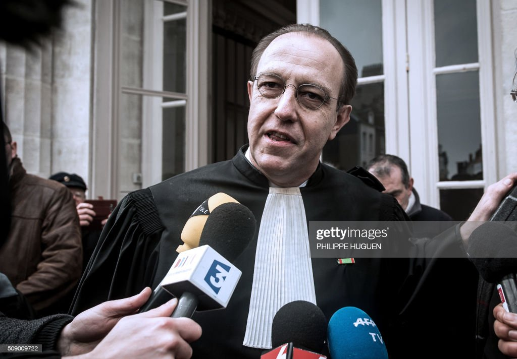 Denis Tailly-Eschenlohr, one the lawyers of French General Christian Piquemal accused of taking part in a banned anti-migrants demonstration, announces to the press the report of the trial for health reasons on February 8, 2016 at the courthouse of Boulogne-sur-Mer, northern France. French General Christian Piquemal is accused with four other of taking part in a banned anti-migrants rally called by Pegida (Patriotic Europeans Against the Islamisation of the Occident) movement. His trial is reported to May 12, 2016. / AFP / PHILIPPE HUGUEN