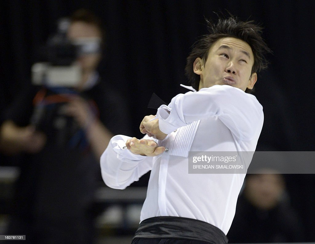 Denis Ten competes for Kazakhstan in the Men's Free Skate event at the 2013 World Figure Skating Championships March 15, 2013 in London, Ontario, Canada. AFP PHOTO/Brendan SMIALOWSKI