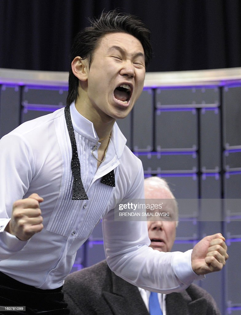 Denis Ten competing for Kazakhstan reacts to his scores in the Men's Free Skate event at the 2013 World Figure Skating Championships March 15, 2013 in London, Ontario, Canada. AFP PHOTO/Brendan SMIALOWSKI