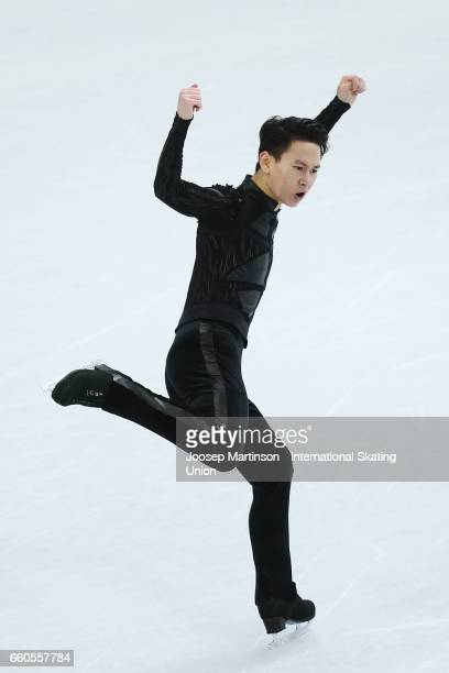 Denis Ten of Kazakhstan competes in the Men's Short Program during day two of the World Figure Skating Championships at Hartwall Arena on March 30...