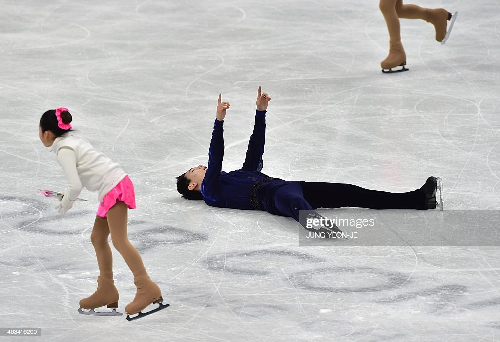<a gi-track='captionPersonalityLinkClicked' href=/galleries/search?phrase=Denis+Ten&family=editorial&specificpeople=5776186 ng-click='$event.stopPropagation()'>Denis Ten</a> (C) of Kazakhstan reacts after finishing his routine in the men's free skating during the ISU Four Continents Figure Skating Championships in Seoul on February 14, 2015.