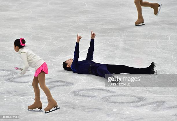 Denis Ten of Kazakhstan reacts after finishing his routine in the men's free skating during the ISU Four Continents Figure Skating Championships in...