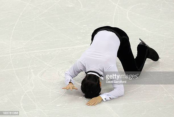 Denis Ten of Kazakhstan slaps the ice at the completion of his skate in the Mens Free Skating Program during the 2013 ISU World Figure Skating...