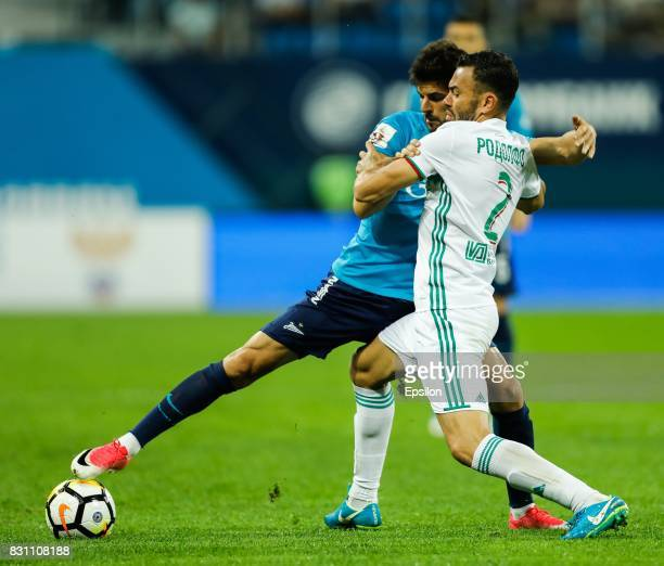 Denis Terentyev of FC Zenit Saint Petersburg and Rodolfo of FC Akhmat Grozny vie for the ball during the Russian Football League match between FC...