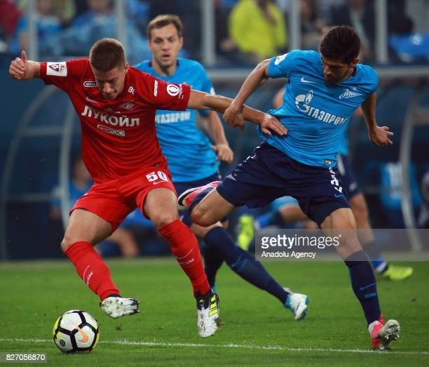 Denis Terentyev of FC Zenit SaintPetersburg in action against Mario Pasalich of FC Spartak Moscow during the Russian Premiere League match between...