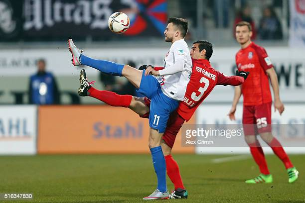 Denis Thomalla of Heidenheim is challenged by Ehsan Hajsafi of Frankfurt during the Second Bundesliga match between 1 FC Heidenheim and FSV Frankfurt...