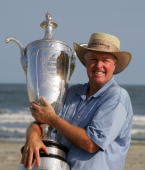 Denis Watson of Zimbabwe poses with the trophy after his twostroke victory at the Senior PGA Championship on the Ocean Course at the Kiawah Island...