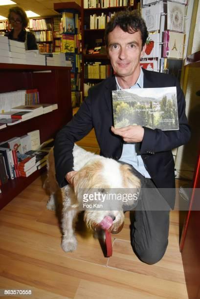 Denis WesthoffÊand dog Utah attend 'Le Pays ou Je Suis Nee' Francoise Sagan Book Launch at Ecume des Pages on October 19 2017 in Paris France Ê