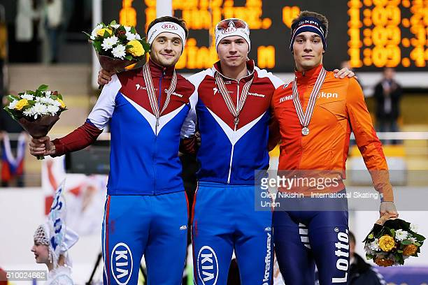 Denis Yuskov Pavel Kulizhnikov both of Russia and Kjeld Nuis of the Netherlands pose with their silver gold and bronze medals of the men's 1000 meter...