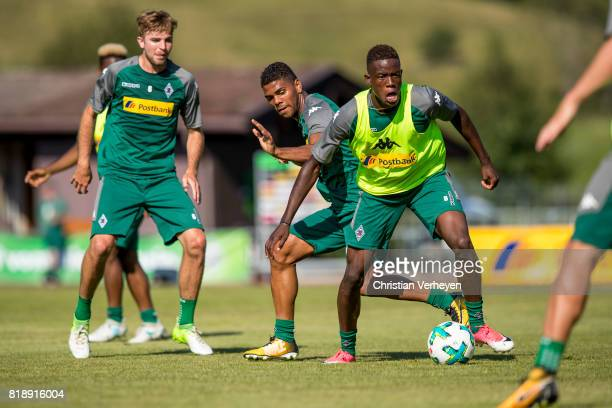Denis Zakaria is chased by Kwame Yeboah and Christoph Kramer during a training session at the Training Camp of Borussia Moenchengladbach on July 19...
