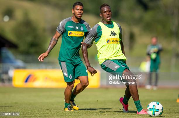 Denis Zakaria is chased by Kwame Yeboah during a training session at the Training Camp of Borussia Moenchengladbach on July 19 2017 in RottachEgern...