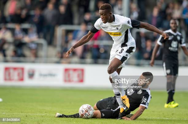 Denis Zakaria of Borussia Moenchengladbach and Luis Garcia of KAS Eupen battle for the ball during the friendly match between KAS Eupen and Borussia...