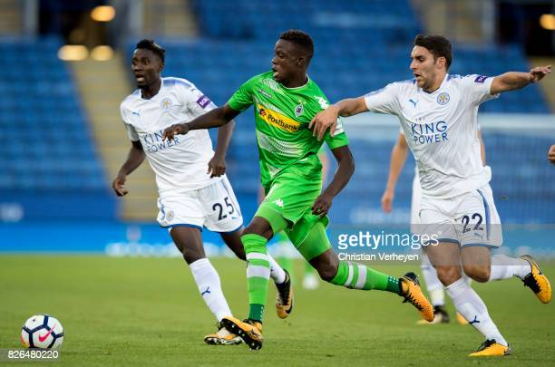 Denis Zakaria of Borussia Moenchengladbach is chased by Matty James of Leicester City during a friendly match between Leicester City and Borussia...