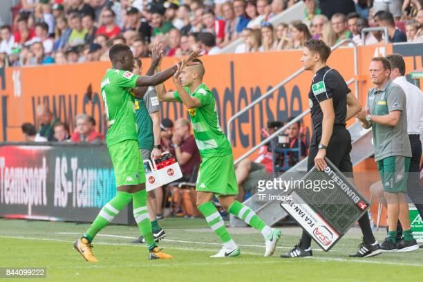 Denis Zakaria of Borussia Moenchengladbach shakes hands with Laszlo Benes of Borussia Moenchengladbach during a Bundesliga match between FC Augsburg...