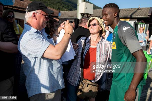 Denis Zakaria of Borussia Moenchengladbach take a picture with a supporter after a training session at the Training Camp of Borussia Moenchengladbach...