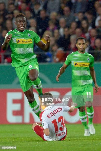 Denis Zakaria of Gladbach and Nico Lucas of Essen battle for the ball during the DFB Cup match between Rot Weiss Essen and Borussia Moenchengladbach...