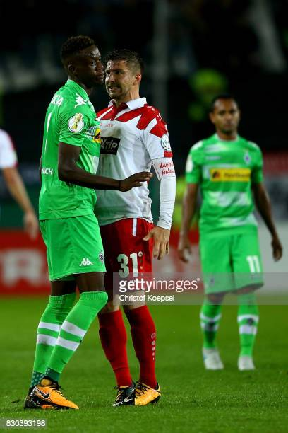 Denis Zakaria of Mnchengladbach and Benjamin Baier of Essen struggle during the DFB Cup first round match between RotWeiss Essen and Borussia...