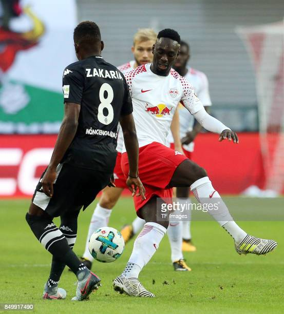 Denis Zakaria of Moenchengladbach and JeanKevin Augustin of Leipzig battle for the ball during the Bundesliga match between RB Leipzig and Borussia...