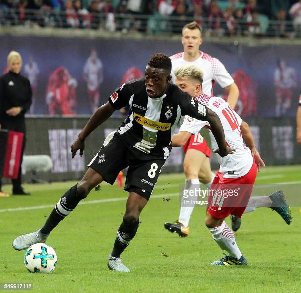 Denis Zakaria of Moenchengladbach and Kevin Kampl of Leipzig battle for the ball during the Bundesliga match between RB Leipzig and Borussia...