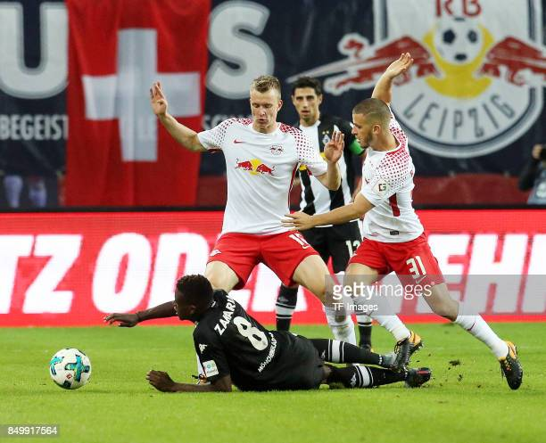 Denis Zakaria of Moenchengladbach and Lukas Klostermann of Leipzig and Diego Demme of Leipzig battle for the ball during the Bundesliga match between...