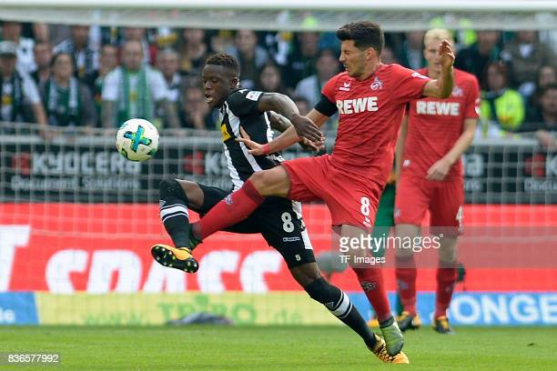 Denis Zakaria of Moenchengladbach and Milos Jojic of Koeln battle for the ball during the Bundesliga match between Borussia Moenchengladbach and 1 FC...
