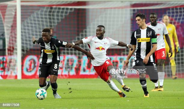 Denis Zakaria of Moenchengladbach and Naby Keita of Leipzig and Thorgan Hazard of Moenchengladbach battle for the ball during the Bundesliga match...
