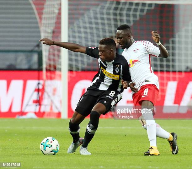 Denis Zakaria of Moenchengladbach and Naby Keita of Leipzig battle for the ball during the Bundesliga match between RB Leipzig and Borussia...