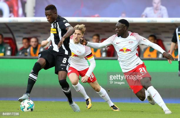 Denis Zakaria of Moenchengladbach and Timo Werner of Leipzig and JeanKevin Augustin of Leipzig battle for the ball during the Bundesliga match...