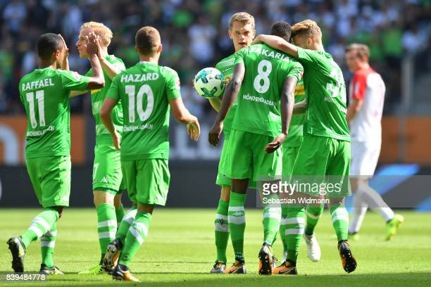 Denis Zakaria of Moenchengladbach celebrates with team mates after he scored to make it 11 during the Bundesliga match between FC Augsburg and...