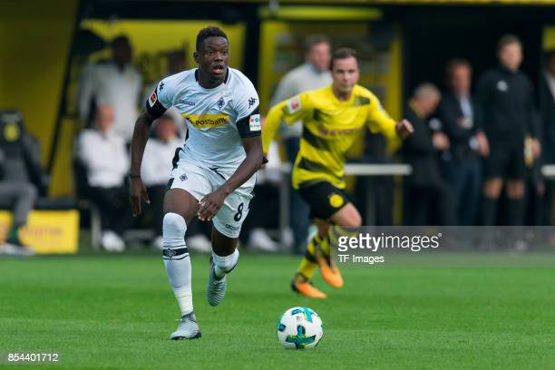 Denis Zakaria of Moenchengladbach controls the ball during the Bundesliga match between Borussia Dortmund and Borussia Moenchengladbach at Signal...