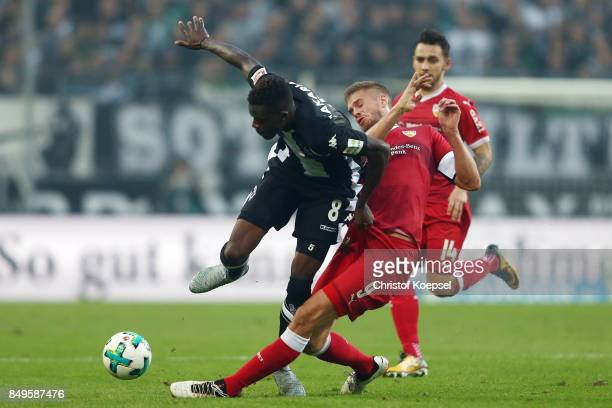 Denis Zakaria of Moenchengladbach fights for the ball with Simon Terodde of Stuttgart during the Bundesliga match between Borussia Moenchengladbach...