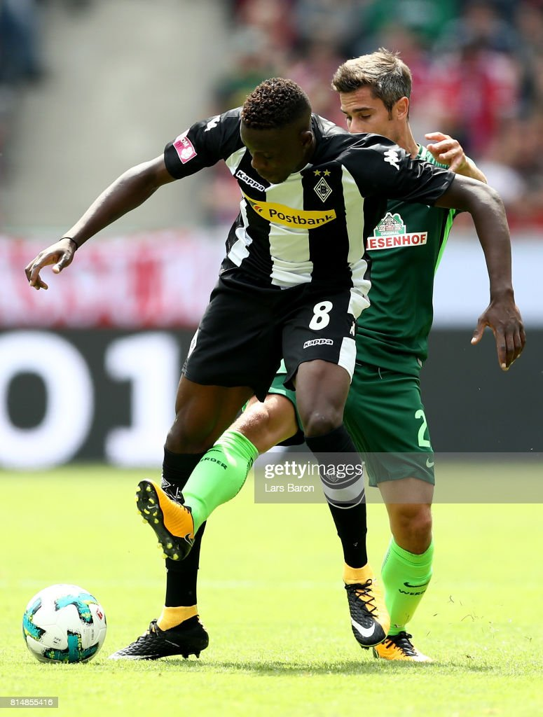 Denis Zakaria of Moenchengladbach is challenged by Fin Bartels of Bremen during the Telekom Cup 2017 match between Borussia Moenchengladbach and Werder Bremen at on July 15, 2017 in Moenchengladbach, Germany.