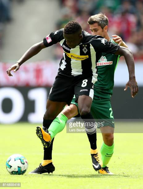 Denis Zakaria of Moenchengladbach is challenged by Fin Bartels of Bremen during the Telekom Cup 2017 match between Borussia Moenchengladbach and...