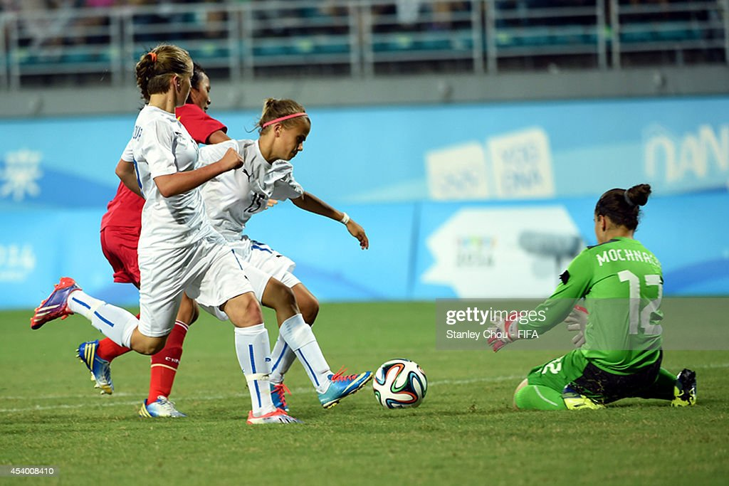 Denisa Mrazikova of Slovakia shields the ball for Denisa Mochnacka during the 2014 FIFA Girls Summer Youth Olympic Football Tournament Semi Final match between China and Slovakia at Wutaishan Stadium on August 23, 2014 in Nanjing, China.