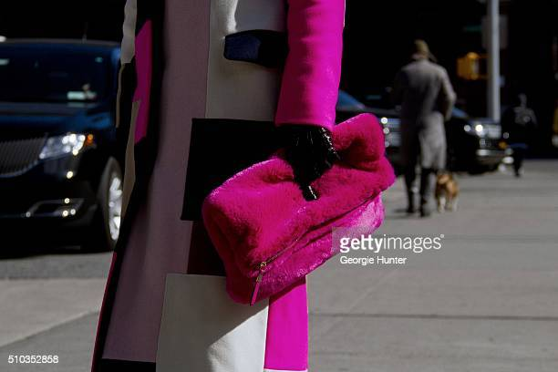 Denisa Palsha seen at Skylight Clarkson Sq outside the Derek Lam show wearing multicolored coat and pink fur clutch bag during New York Fashion Week...