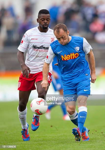 DenisDanso Weidlich of Regensburg battles for the ball with Alexander Iashvilli of Bochum during the Second Bundesliga match betweeen SSV Jahn...