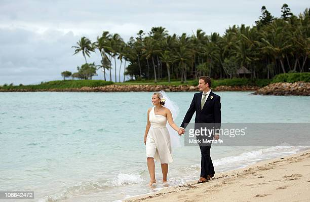 Denise and Mark DuffieldThomas walk along the beach after renewing their wedding vows for the 81st time at Hayman Island on November 9 2010 in the...