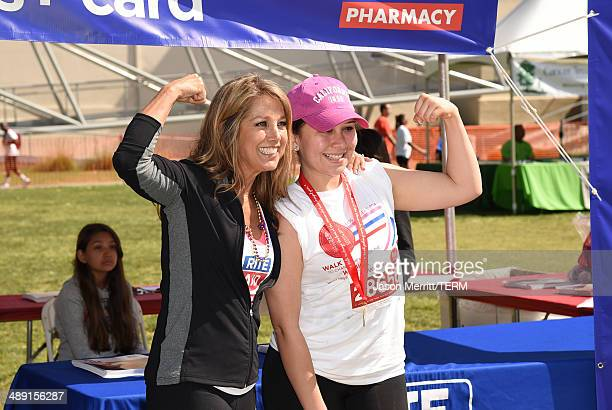 Denise Austin and a participant attend the 21st Annual EIF Revlon Run Walk For Women on May 10 2014 in Los Angeles California