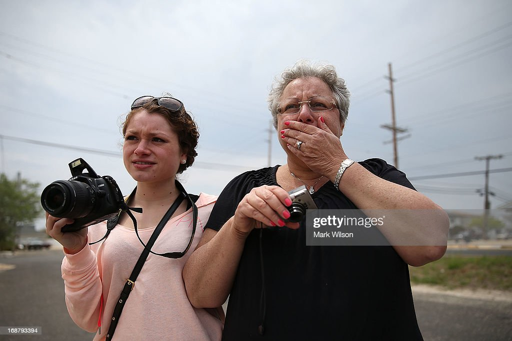 Denise Avrutik (R) gets emotional as she and her daughter Julianne Avrutik, watch the home she grew up in get demolished after it was damaged six months ago by Superstorm Sandy, May 15, 2013 in Ortley Beach, New Jersey. Mrs. Avrutik's family has owned the home since 1959 when she was only three years old. The nearby town of Mantoloking had all 528 homes either damaged or destroyed by the storm and say that at least 50 homes are scheduled to be demolished in the upcoming weeks.