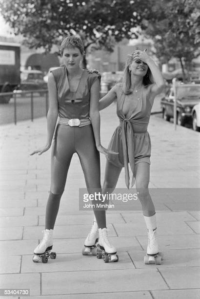 Denise Crosby granddaughter of singer Bing Crosby out rollerskating with bunny girl Candy Moore 25th October 1978 Crosby who is wearing an outfit...