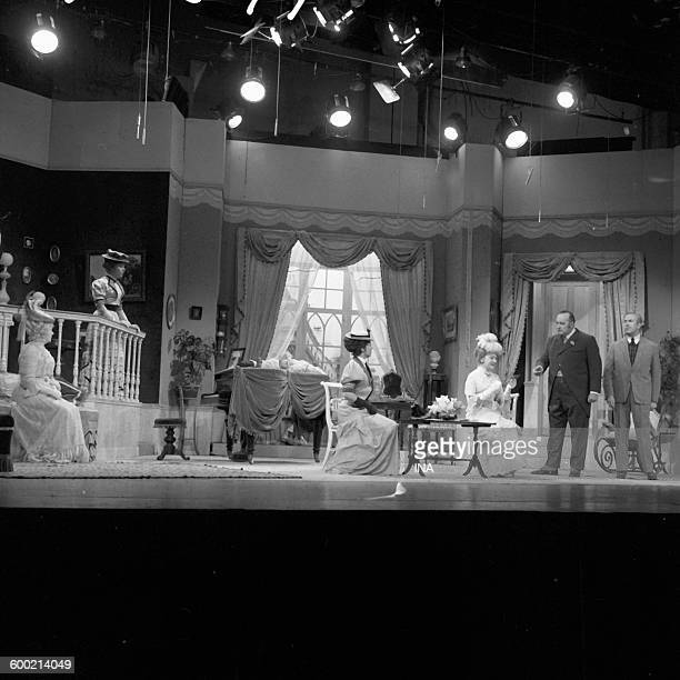 Denise Grey Nadine Basile Micheline Luccioni Edwige Feuillère Michel Nastorg and Guy Tréjan in a scene of 'Constance' play of Somerset Maugham...