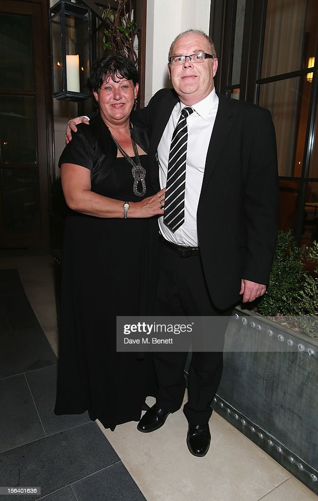 Denise Harris and Andy Harris show armed forces support at the 'Give Us Time' fundraiser held at Corinthia Hotel London on November 14, 2012 in London, England.