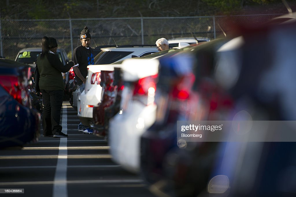 Denise Hicks left and Melvin Washington shop for a cars at Stewart Chevrolet Cadillac dealership in Colma California US on Wednesday Jan 30 2013 US...