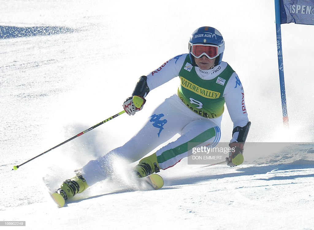 Denise Karbon of Italy clears a gate during the first run of the women's World Cup giant slalom in Aspen on November 24, 2012. AFP PHOTO/Don EMMERT