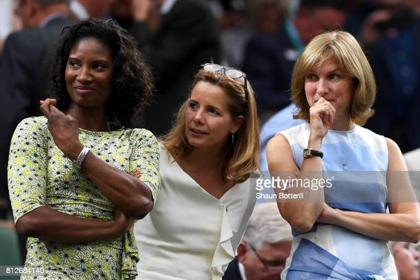 Denise Lewis crosses her fingers as Darcey Bussell and Fiona Bruce look on from the centre court royal box during the Ladies Singles quarter final...