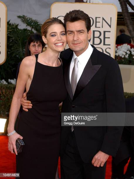 Denise Richards and Charlie Sheen arrive for the Golden Globe Awards at the Beverly Hilton Hotel in Beverly Hills California January 20 2002
