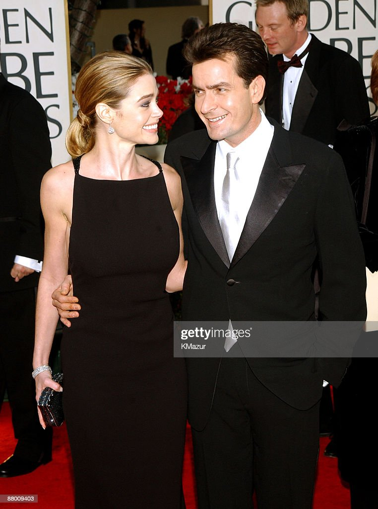 Denise Richards & Charlie Sheen arrive at the Golden Globe Awards at the Beverly Hilton January 20, 2002 in Beverly Hills, California.