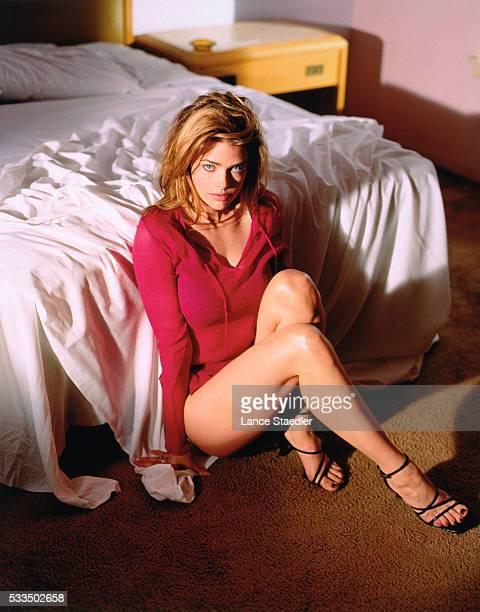 Denise Richards Leaning Against Bed