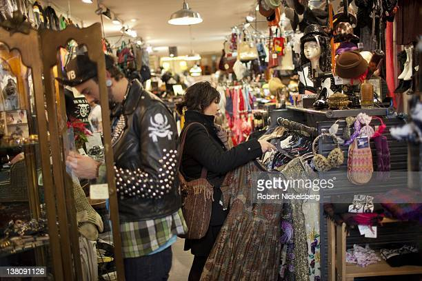 Denise Romero a 21 year old MexicanAmerican looks for a blouse while shopping January 2 2012 in a thrift store in Brooklyn New York